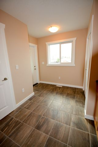 Photo 4: 8720 76 Street in Fort St. John: 1/2 Duplex for sale