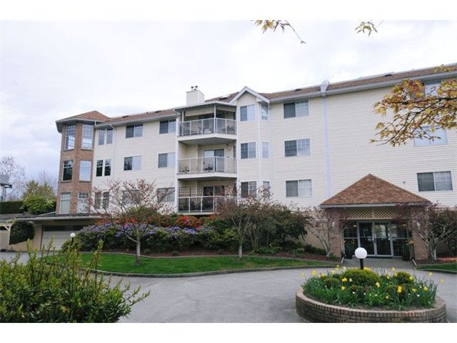 """Main Photo: 308 22611 116TH Avenue in Maple Ridge: East Central Condo for sale in """"ROSEWOOD COURT"""" : MLS®# V1058553"""