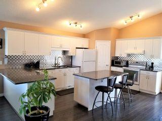 Photo 8: 2056 BRENNAN Crescent in Edmonton: Zone 58 House for sale : MLS®# E4263935