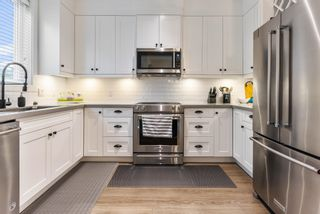 """Main Photo: 2 5945 177B Street in Surrey: Cloverdale BC Townhouse for sale in """"THE CLOVER"""" (Cloverdale)  : MLS®# R2627382"""