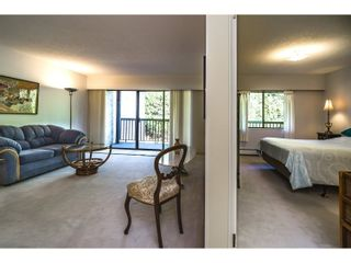 "Photo 11: 210 150 E 5TH Street in North Vancouver: Lower Lonsdale Condo for sale in ""NORMANDY HOUSE"" : MLS®# R2051568"