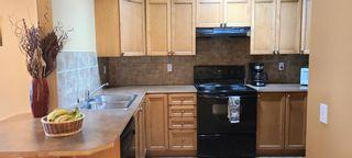 Photo 8: 106 248 Sunterra Ridge Place: Cochrane Apartment for sale : MLS®# A1097518