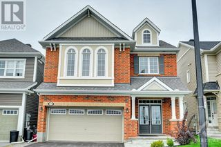 Photo 1: 137 FLOWING CREEK CIRCLE in Ottawa: House for sale : MLS®# 1265124