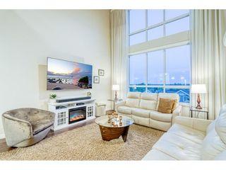 "Photo 1: 403 6480 194 Street in Surrey: Clayton Condo for sale in ""Waterstone"" (Cloverdale)  : MLS®# R2467740"