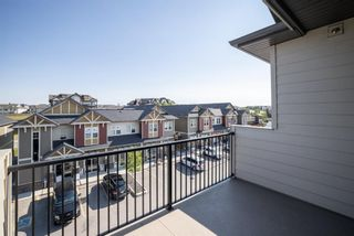 Photo 25: 9308 101 Sunset Drive: Cochrane Apartment for sale : MLS®# A1141889