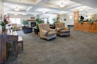 Photo 28: 306 77 George Fox Trail: Cochrane Apartment for sale : MLS®# A1139159