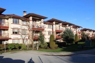 "Photo 1: 109 16477 64 Avenue in Surrey: Cloverdale BC Condo for sale in ""St. Andrews"" (Cloverdale)  : MLS®# R2526861"