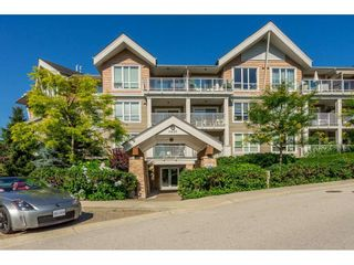 "Photo 1: 104 6420 194 Street in Surrey: Clayton Condo for sale in ""WATERSTONE"" (Cloverdale)  : MLS®# R2480446"