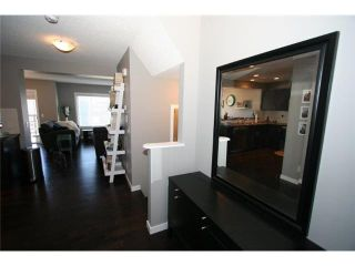 Photo 3: 225 SUNSET Common: Cochrane Residential Attached for sale : MLS®# C3590396