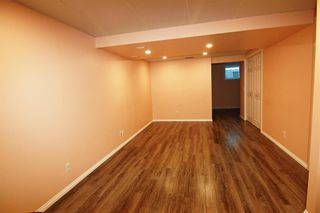 Photo 8: 105 New Brighton Park SE in Calgary: New Brighton Detached for sale : MLS®# A1120372
