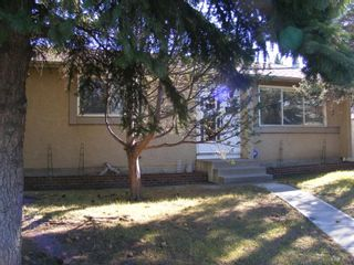Photo 2: 207 Pinecliff Way NE in Calgary: Pineridge Detached for sale : MLS®# A1108263