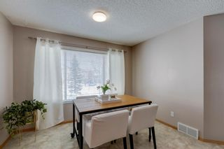 Photo 16: 105 Rocky Ridge Court NW in Calgary: Rocky Ridge Row/Townhouse for sale : MLS®# A1069587