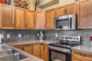 Photo 8: 1401 281 COUGAR RIDGE Drive SW in Calgary: Cougar Ridge Row/Townhouse for sale : MLS®# A1070231
