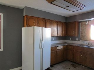 """Photo 2: 8415 89 Avenue in Fort St. John: Fort St. John - City SE House for sale in """"DUNCAN CRAN"""" (Fort St. John (Zone 60))  : MLS®# R2223970"""