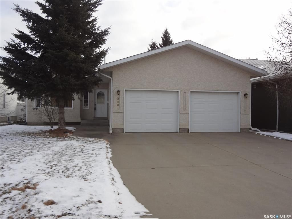 Outside front with large concrete driveway