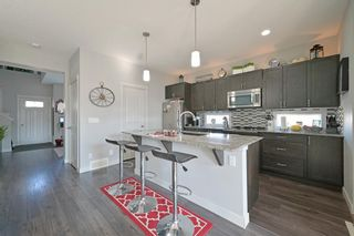 Photo 6: 870 Nolan Hill Boulevard NW in Calgary: Nolan Hill Row/Townhouse for sale : MLS®# A1096293