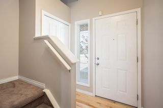 Photo 3: 8 Everridge Gardens SW in Calgary: Evergreen Row/Townhouse for sale : MLS®# A1041120