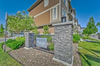 Photo 1: 539 Panatella Walk NW in Calgary: Panorama Hills Row/Townhouse for sale : MLS®# A1125854
