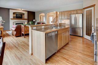 Photo 9: 244 SUNSET Close: Cochrane Detached for sale : MLS®# C4305760