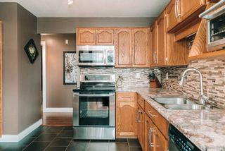 """Photo 8: 312 33375 MAYFAIR Avenue in Abbotsford: Central Abbotsford Condo for sale in """"MAYFAIR PLACE"""" : MLS®# R2604719"""