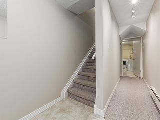 Photo 3: 516 3130 66 Avenue SW in Calgary: Lakeview Row/Townhouse for sale : MLS®# A1024120