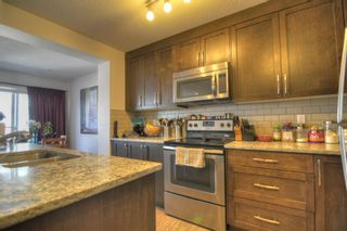 Photo 4: 403 2400 Ravenswood View SE: Airdrie Row/Townhouse for sale : MLS®# A1111114