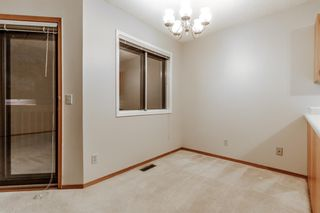 Photo 10: 10 Sandarac Circle NW in Calgary: Sandstone Valley Row/Townhouse for sale : MLS®# A1145487