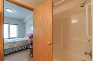 Photo 16: 241 223 Tuscany Springs Boulevard NW in Calgary: Tuscany Apartment for sale : MLS®# A1108952
