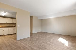 Photo 5: 101 1540 29 Street NW in Calgary: St Andrews Heights Row/Townhouse for sale : MLS®# A1108207
