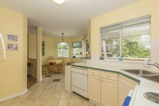 Photo 9: 412 13900 HYLAND ROAD in Surrey: East Newton Townhouse for sale : MLS®# R2112905