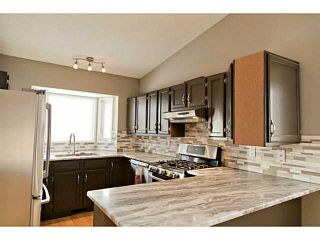 Photo 4: 80 WOODBINE Boulevard SW in Calgary: Woodbine Residential Detached Single Family for sale : MLS®# C3645592