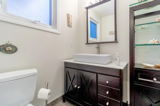 Photo 15: 143 Silver Brook Road NW in Calgary: Silver Springs Detached for sale : MLS®# A1141284