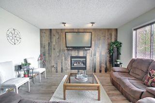 Photo 3: 140 Douglas Ridge Green SE in Calgary: Douglasdale/Glen Detached for sale : MLS®# A1114470