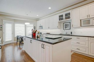 Main Photo: 39 Prominence Point SW in Calgary: Patterson Duplex for sale : MLS®# A1076350