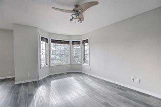 Photo 4: 30 MACEWAN RIDGE Place in Calgary: MacEwan Glen Detached for sale : MLS®# A1092445