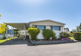 "Photo 1: 58 8254 134 Street in Surrey: Queen Mary Park Surrey Manufactured Home for sale in ""WESTWOOD ESTATES"" : MLS®# R2358932"