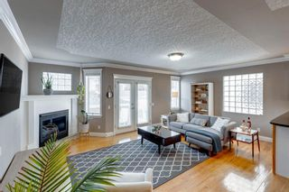 Photo 1: 2107 4 Avenue NW in Calgary: West Hillhurst Row/Townhouse for sale : MLS®# A1129875