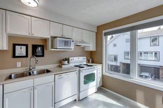 Photo 10: 81 Coachway Gardens SW in Calgary: Coach Hill Row/Townhouse for sale : MLS®# A1147900