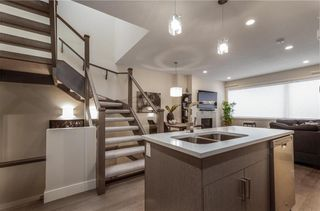 Photo 5: 2 1920 25A Street SW in Calgary: Richmond Row/Townhouse for sale : MLS®# A1127031