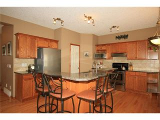 Photo 9: 18 WEST POINTE Manor: Cochrane House for sale : MLS®# C4072318