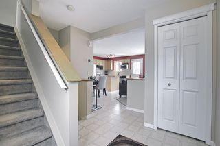 Photo 4: 8050 Cougar Ridge Avenue SW in Calgary: Cougar Ridge Detached for sale : MLS®# A1086760