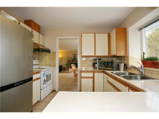 """Photo 5: 624 IOCO Road in Port Moody: North Shore Pt Moody House for sale in """"PLEASANTSIDE COMMUNITY"""" : MLS®# V829422"""