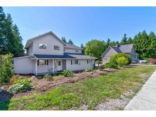 """Photo 1: 2125 128 Street in Surrey: Crescent Bch Ocean Pk. House for sale in """"Ocean Park"""" (South Surrey White Rock)  : MLS®# R2591158"""