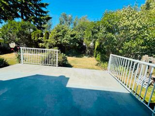 Photo 1: 8721 AUGUST Drive in Surrey: Fleetwood Tynehead House for sale : MLS®# R2601939