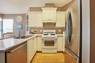 "Photo 9: 16 17917 68 Avenue in Surrey: Cloverdale BC Townhouse for sale in ""Weybridge"" (Cloverdale)  : MLS®# R2603694"