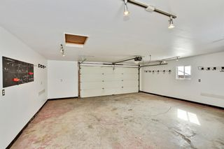 Photo 31: 36 SHAWINIGAN Drive SW in Calgary: Shawnessy Detached for sale : MLS®# A1009560