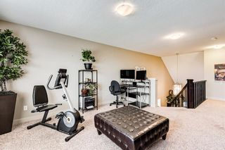 Photo 18: 105 Rainbow Falls Boulevard: Chestermere Semi Detached for sale : MLS®# A1144465