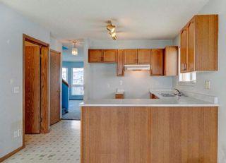 Photo 9: 254 SARATOGA Close NE in Calgary: Monterey Park House for sale : MLS®# C4165371