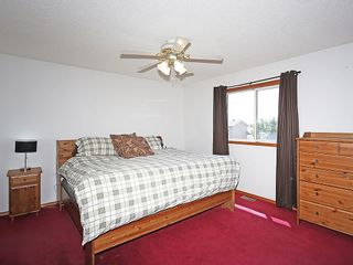Photo 18: 1103 THORBURN Drive SE: Airdrie House for sale