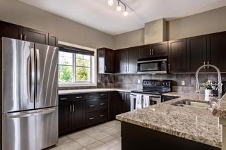 Photo 8: 1503 281 Cougar Ridge Drive SW in Calgary: Cougar Ridge Row/Townhouse for sale : MLS®# A1149149
